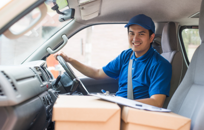 delivery man in truck smiling