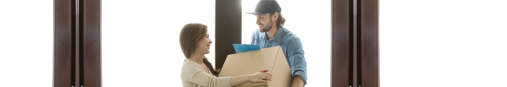delivery man handing a package to a customer